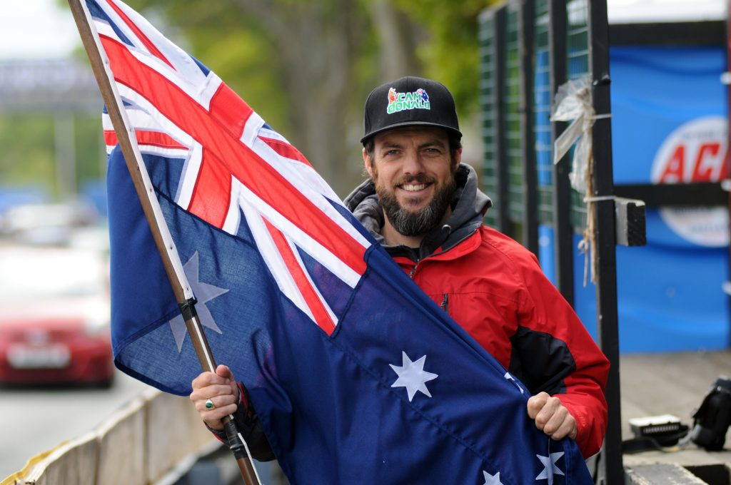 PACEMAKER BELFAST 29/05/13: Australian TT star and Wilson Craig Honda rider Cameron Donald with his national flag at the 2013 Isle of Man TT PHOTO BY PACEMAKER