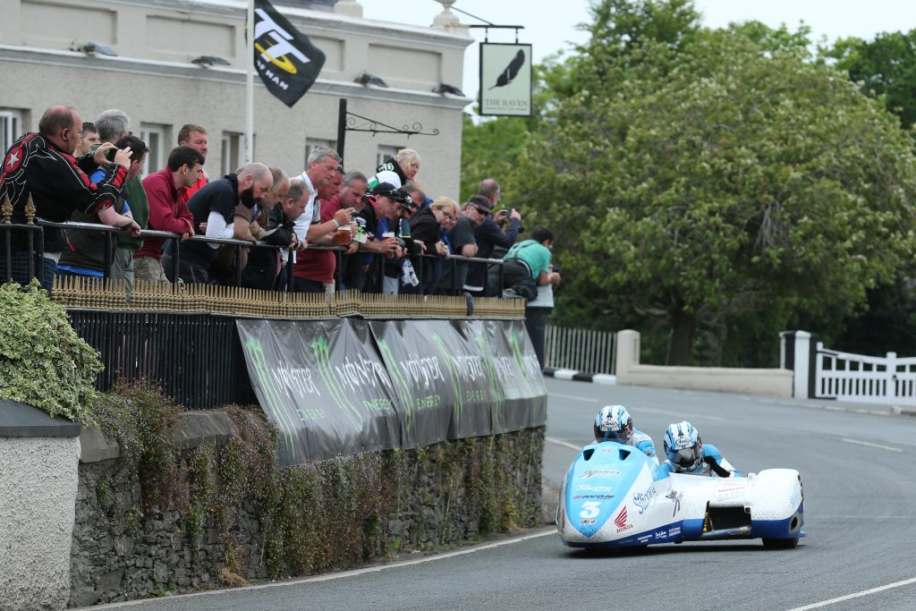 DAVE KNEEN/PACEMAKER PRESS, BELFAST: 04/06/2016: John Holden and Andy Winkle (LCR Honda - Silicone Engineering/Barnes Racing) at Ballaugh Bridge during the Sure Mobile Sidecar TT race.