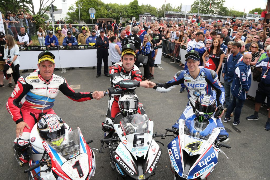 PACEMAKER BELFAST 10/06/16: Buildbase BMW rider Michael Dunlop celebrates with runner up Ian Hutchinson and third placed John McGuinness after winning the Pokerstars Senior TT at the 2016 Isle of Man TT PHOTO BY STEPHEN DAVISON