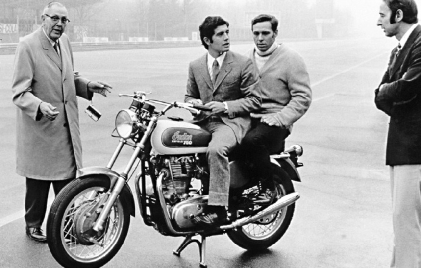 Monza 1969 and Tartarini (right) chats with Giacomo Agostini as he sits astride an Italjet Grifon